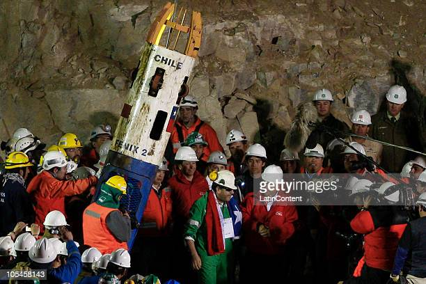 Miner Luis Urzua is greeted by Chile's President Sebastian Pinera after being sucessfuly lifted to the surface during the rescue operation of 33...