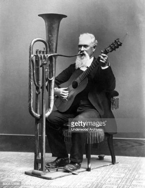 Miner musician and photographer Charles Wallace Jacob Johnson playing his handsfree tuba in his one man band Monterey California circa 1890