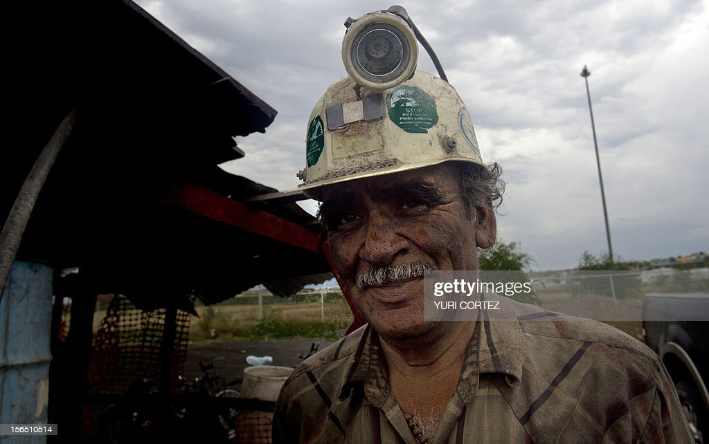A miner poses for a picture at a mine in Agujita, Coahuila State in Mexico on November 13, 2012. According to the Mining Chamber of Mexico, the country produces annually 15 million tons of coal, with an average annual production worth USD 3,800 million, representing 1.6% of the country's Gross Domestic Product (GDP) . The bulk of the coal is used for power generation and steel production. Recent press reports affirm that drugs cartel are involved in the coal-related activities.