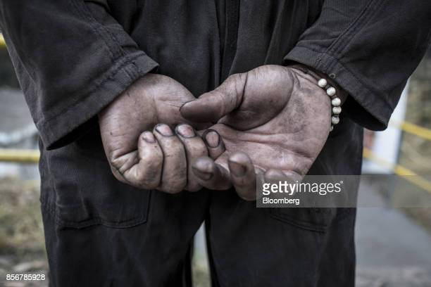 A miner prays for protection before the start of the morning shift at a coal mine in Cucunuba Cundinamarca Department Colombia on Friday July 28 2017...