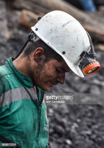 A miner reacts during search operations after an explosion at the El Cerezo illegal coal mine killed at least eight people in the rural area of...