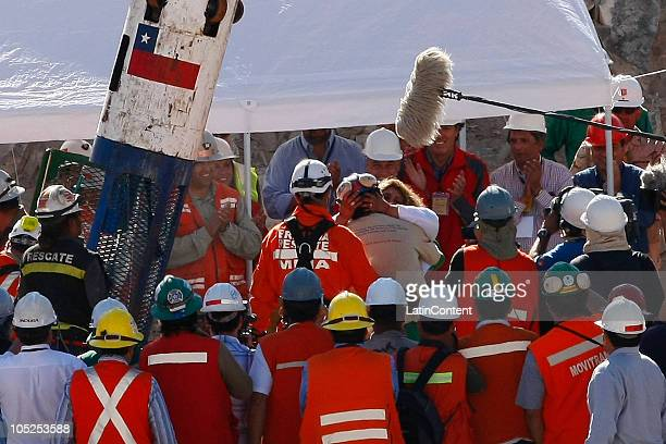 Miner Samuel Avalos is embraced by his wife during the rescue operation of 33 miners trapped 700 meters underground for two months in the San Jose...
