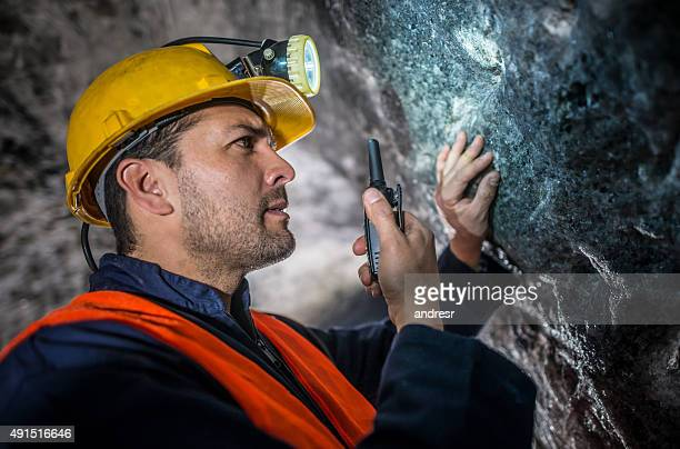 Miner talking on a walkie-talkie