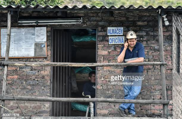A miner talks on a cellphone during search operations after an explosion at the El Cerezo illegal coal mine killed at least eight people in the rural...