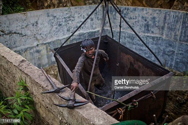 A miner unloads tools after being hoisted 300ft from the depths of a coal mine for his lunch break on April 13 2011 near the village of Latyrke near...