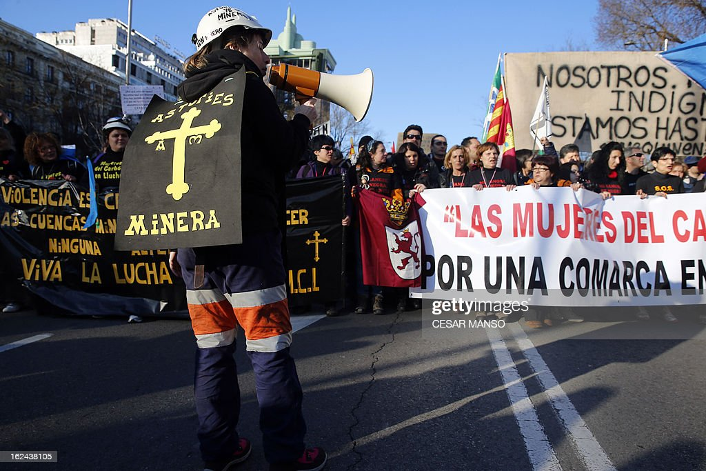 A miner uses a loudspeaker to shout slogans during a protest against government austerity on February 23, 2013 in Madrid. Nurses, doctors, students, miners and members of Spain's 'indignant' movement against economic inequality join in the so-called 'citizens' tide' against the steep spending cuts and tax hikes imposed by Prime Minister Mariano Rajoy's conservative government to slash the public deficit. The day of protest coincides with the 31st anniversary of the failure of right-wing military coup that sought to crush Spain's young democracy and restore military rule. AFP PHOTO / CESAR MANSO