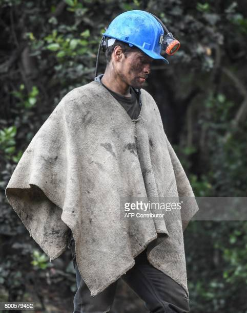 A miner waits during search operations a day after an explosion at the El Cerezo illegal coal mine killed at least eight people in the rural area of...