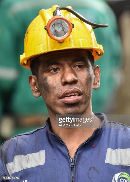 A miner waits during search operations after an explosion at the El Cerezo illegal coal mine killed at least eight people in the rural area of...