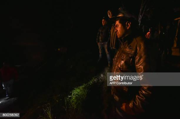 A miner watches a search operation outside of 'La Guasca' mine in a rural area of Cucunuba Cundinamarca department on June 24 2017 An explosion at a...