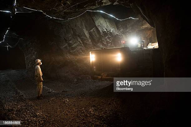 A miner watches as a loading machine moves rock ore from the digging floor at the Yalea underground gold mine part of the LouloGounkoto gold mine...