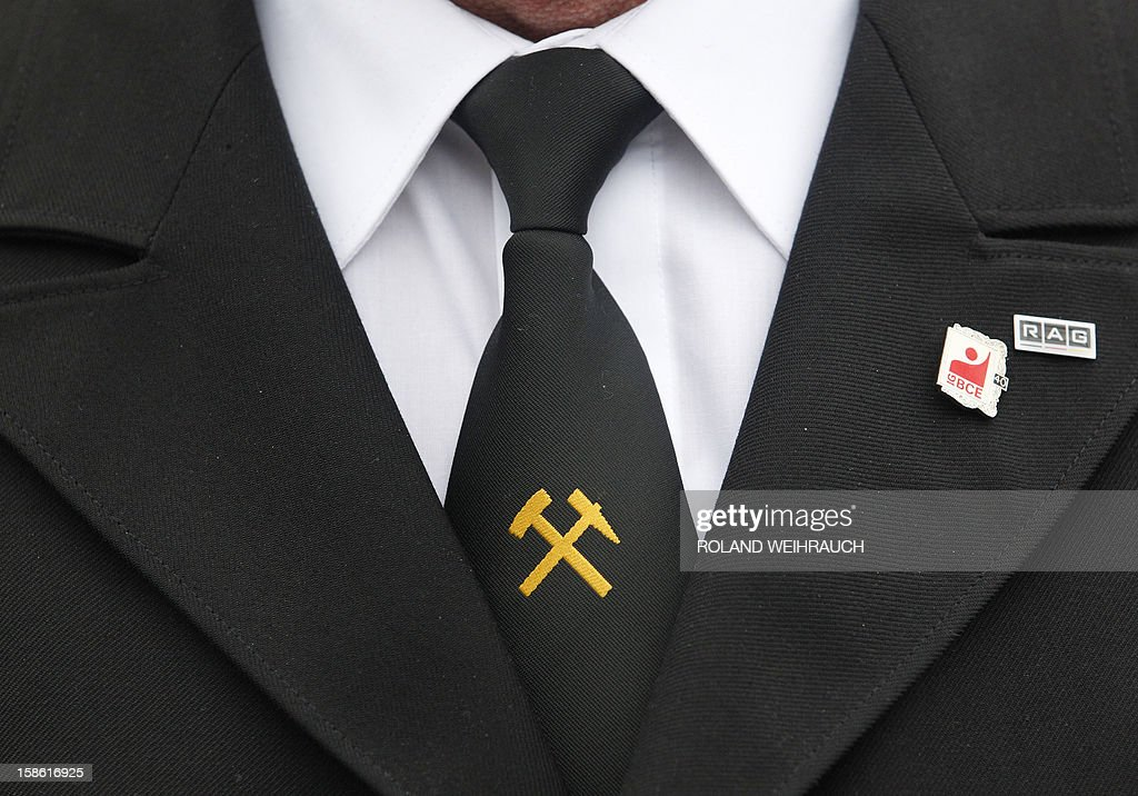 A miner wearing a black suit attends the closing ceremony after the very last mining shift at Mine West in Kamp-Lintfort, western Germany, on December 21, 2012. The mine will be shut down after being active for around 100 years.