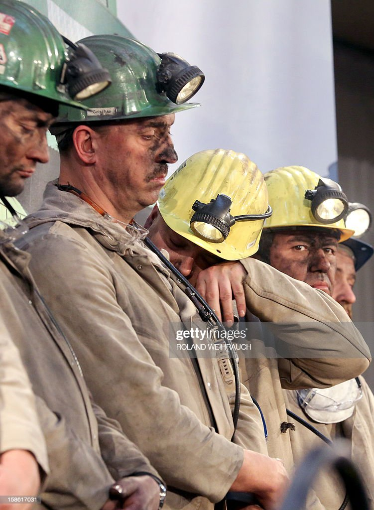 A miner wipes off tears during the closing ceremony after the very last mining shift at Mine West in Kamp-Lintfort, western Germany, on December 21, 2012. The mine will be shut down after being active for around 100 years.