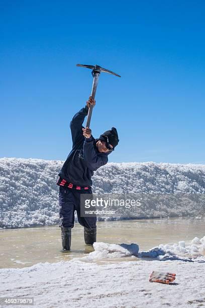 miner with pick axe on salt flat
