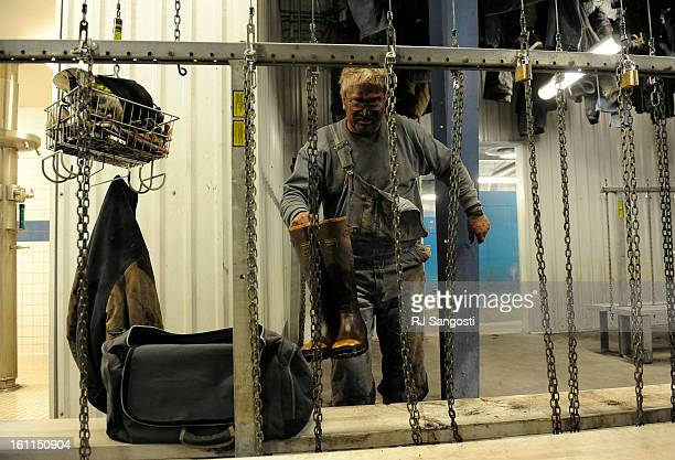 MINER06Coal mining longwall foreman Alan Waddle takes off his boots in the bath house at the Oxbox Coal Mine in Somerset Colorado after his shift 'We...