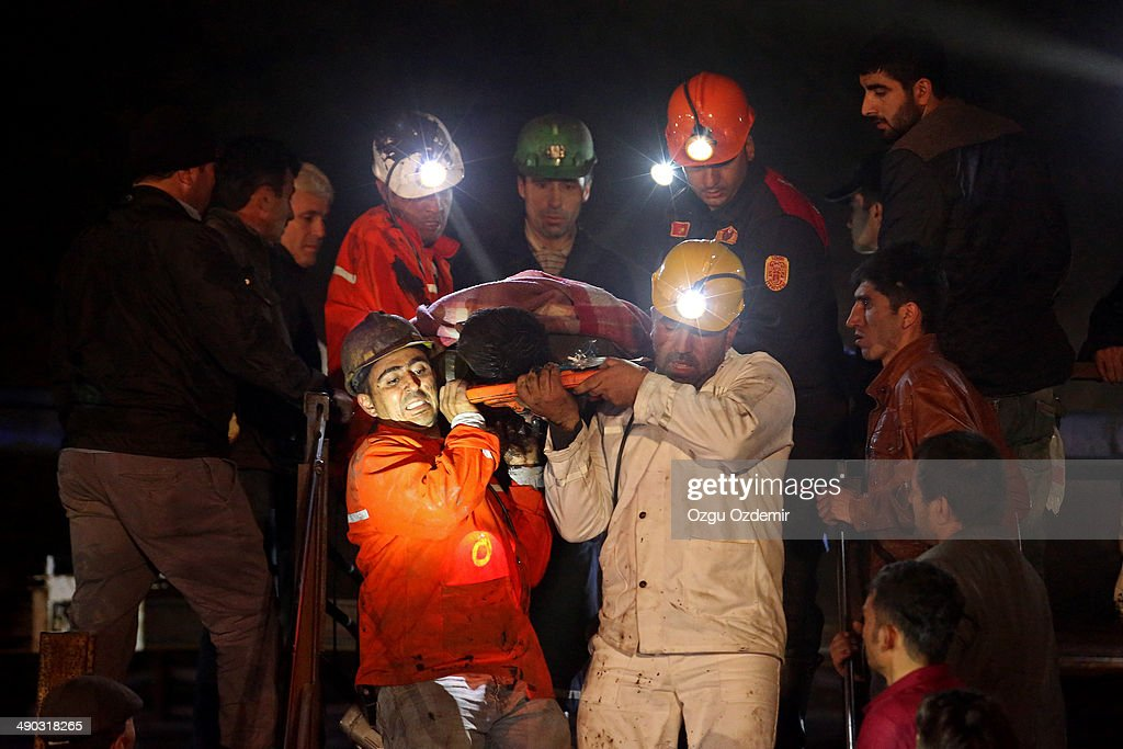 Miners are helped by rescue workers and friends from the coal mine on May 14 2014 in Soma Manisa Turkey An explosion and fire in the coal mine killed...