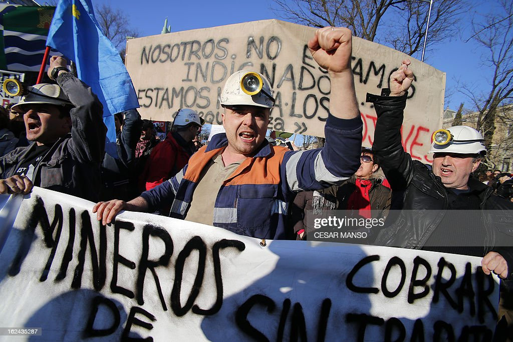 Miners attend a protest against government austerity on February 23, 2013 in Madrid. Nurses, doctors, students, miners and members of Spain's 'indignant' movement against economic inequality join in the so-called 'citizens' tide' against the steep spending cuts and tax hikes imposed by Prime Minister Mariano Rajoy's conservative government to slash the public deficit. The day of protest coincides with the 31st anniversary of the failure of right-wing military coup that sought to crush Spain's young democracy and restore military rule.