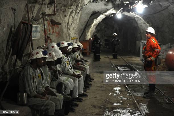 Miners attend a security briefing on October 10 2013 at the Cullinan Diamond Mine 100 kms northeast of Johannesburg The mine is famous for large high...