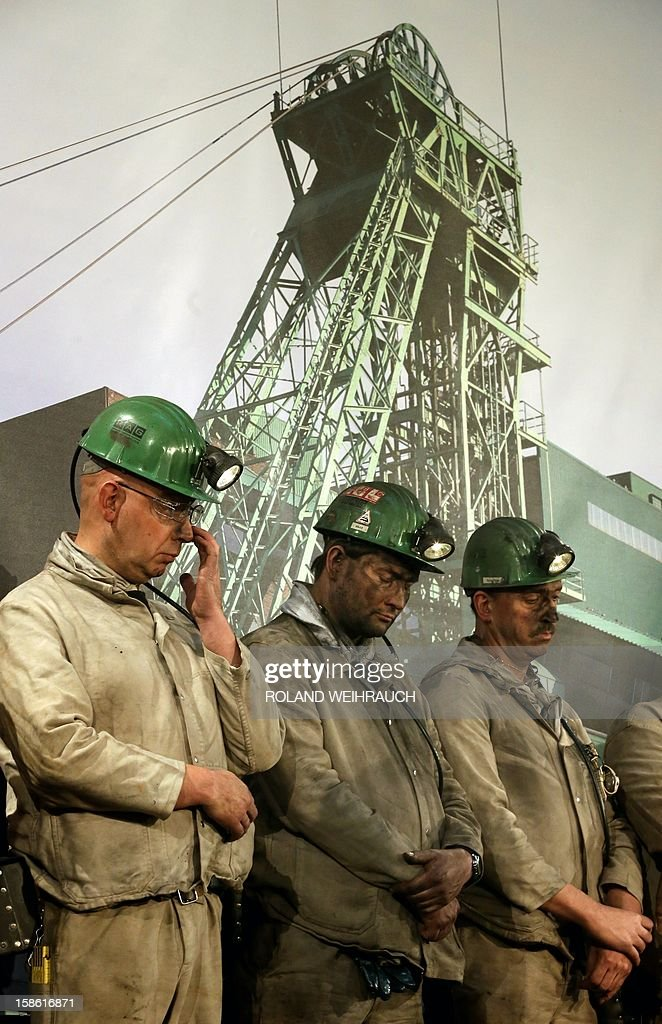 Miners attend the closing ceremony after the very last mining shift at Mine West in Kamp-Lintfort, western Germany, on December 21, 2012. The mine will be shut down after being active for around 100 years.