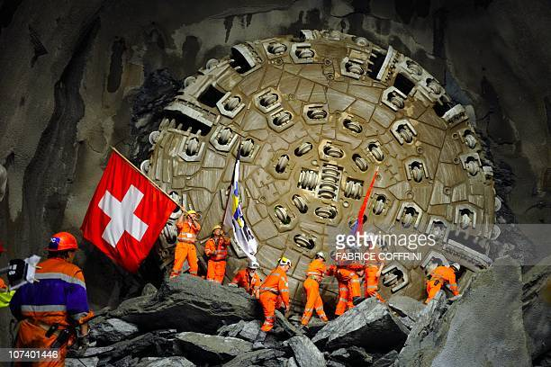 Miners celebrate after a giant drilling machine completed the world's longest tunnel beneath the Swiss Alps on October 15 2010 during a ceremony 30...