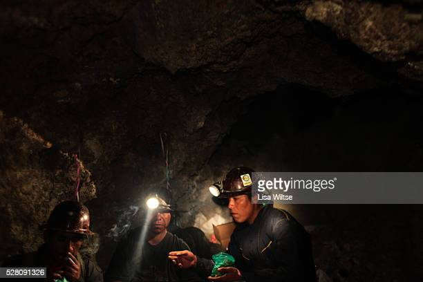 Miners chew coca and pay their respects to the uncle of the mine during the Oruro Carnival The offerings include coca leaves alcohol tobacco and...