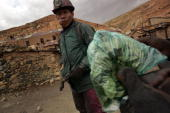 Miners chew on coca leaves before entering the San Jose Mine to dig for tin and silver December 14 2005 in Oruro Bolivia Miners a crucial sector of...