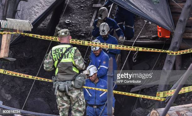 Miners descend into the El Cerezo mine during search operations after an explosion at the illegal coal mine killed at least eight people in the rural...