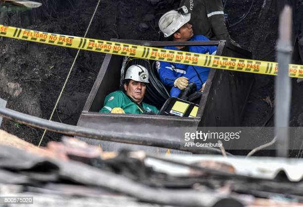 Miners descend into the El Cerezo mine during search operations in a rural area of Cucunuba Cundinamarca Department Colombia on June 24 2017 An...