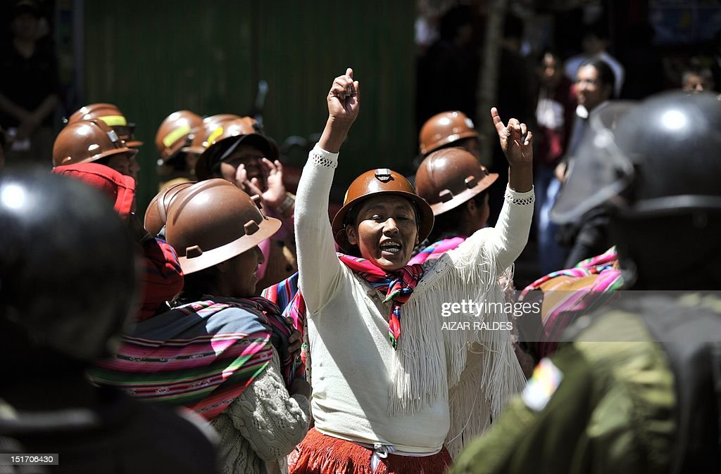 Miners from private cooperatives and their relatives protest along downtown La Paz on September 10, 2012 demanding to the government the cession to their sector the right of exploitation of the tin-rich Rosario seam. AFP PHOTO/Aizar Raldes