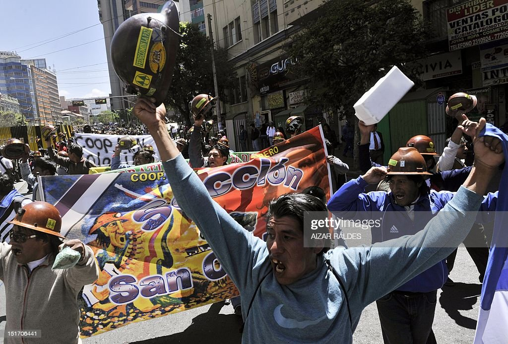 Miners from private cooperatives protest along downtown La Paz on September 10, 2012 demanding to the government the cession to their sector the right of exploitation of the tin-rich Rosario seam. AFP PHOTO/Aizar Raldes