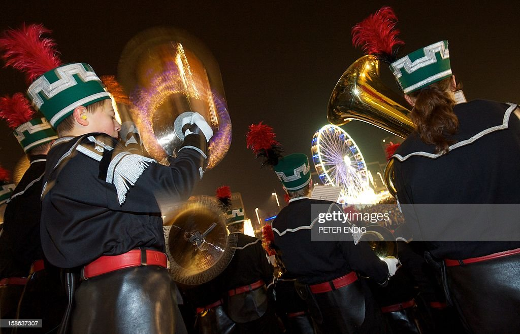 Miners from the Ore Mountains in their traditional dresses take part in the Christmas Miners Parade on December 22, 2012 in Leipzig, eastern Germany.