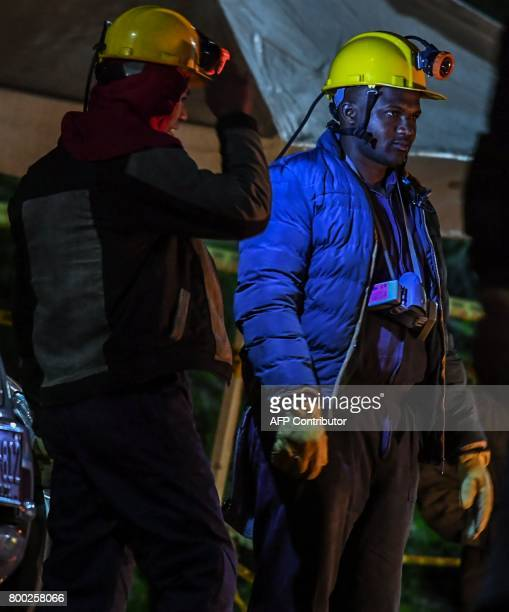A miners gestures during search operations outside of 'La Guasca' mine in a rural area of Cucunuba Cundinamarca department on June 24 2017 An...
