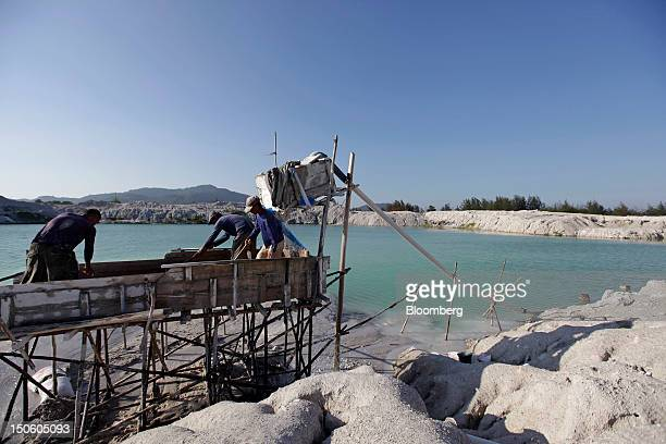 Miners labor on a platform as they sluice for tin ore at a mine in Sungai Liat Bangka Island Indonesia on Friday July 27 2012 In recent years about...