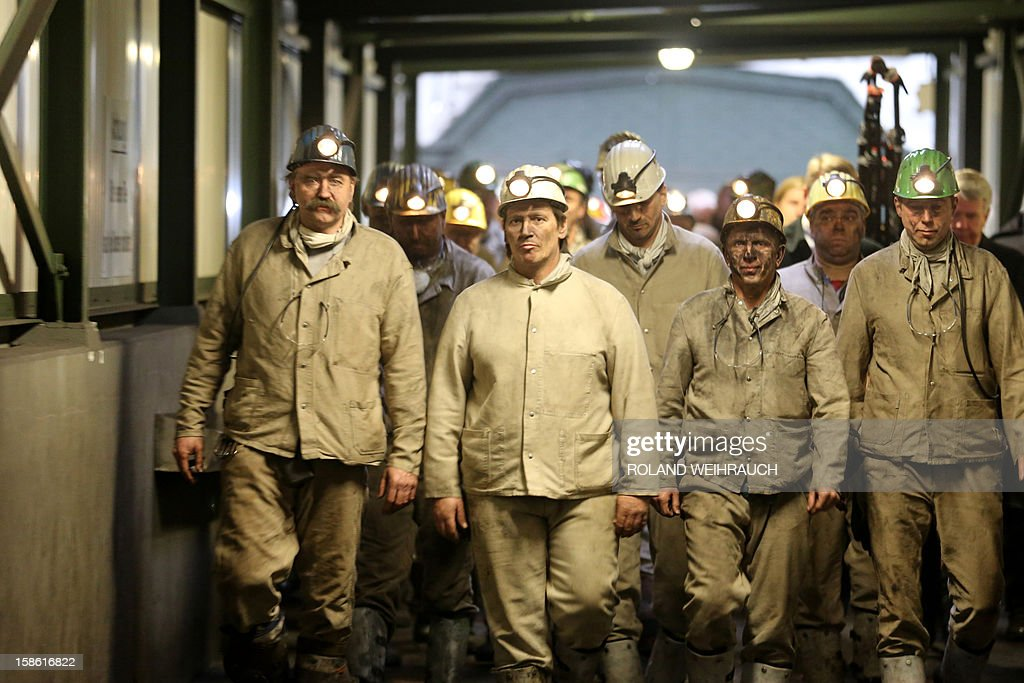 Miners leave mine shaft 1 after the very last mining shift at Mine West in Kamp-Lintfort, western Germany, on December 21, 2012. The mine will be shut down after running around 100 years. AFP PHOTO / ROLAND WEIHRAUCH GERMANY OUT