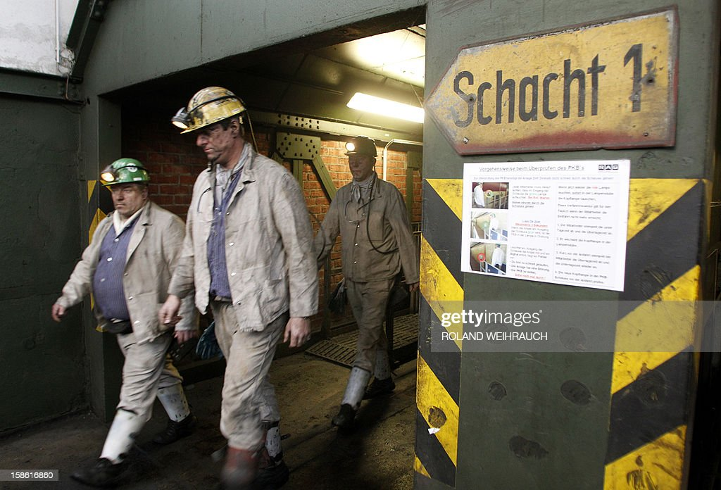 Miners leave mine shaft 1 after the very last mining shift at Mine West in Kamp-Lintfort, western Germany, on December 21, 2012. The mine will be shut down after being active for around 100 years.