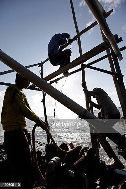 Miners operate a bamboo raft used to dredge for tin ore in the waters off Batu Belubang Bangka Island Indonesia on Saturday July 28 2012 In recent...