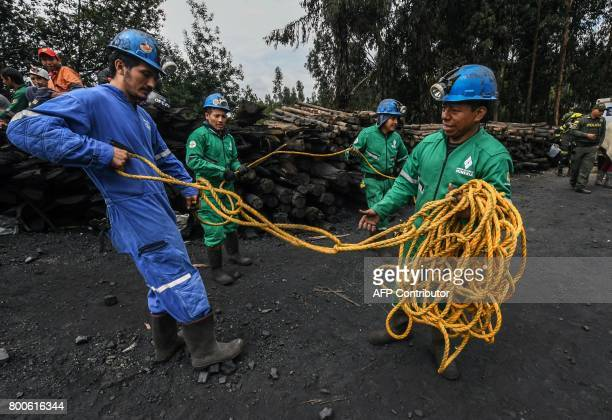 Miners prepare a rope to help in the search operations a day after an explosion at the El Cerezo illegal coal mine killed at least eight people in...