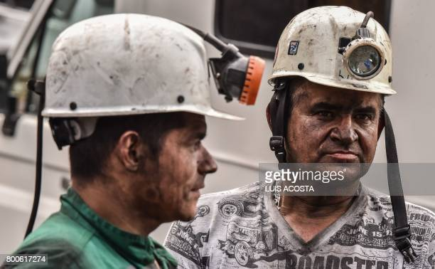 Miners react during search operations after an explosion at the El Cerezo illegal coal mine killed at least eight people in the rural area of...