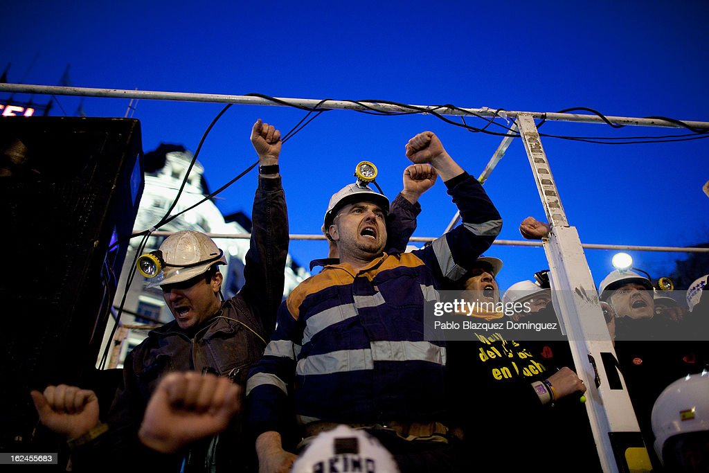 Miners shout slogans at Neptuno Square during a march by thousands of people on February 23, 2013 in Madrid, Spain. Public health workers, civil servants and disaffected citizens converged on central Madrid to protest against the austerity measures of Prime Minister Mariano Rajoy.