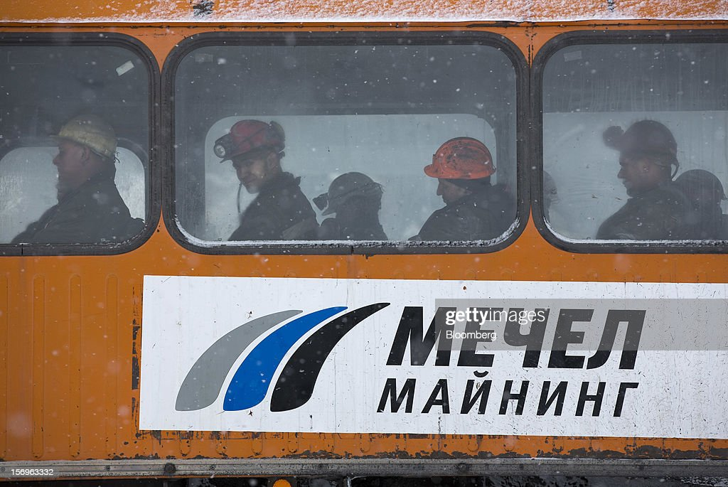 Miners sit in a bus before leaving the excavation site after finishing their shift at the Sibirginsky open pit coal mine, owned by OAO Mechel and operated by Southern Kuzbass Coal Co., near Myski, in Kemerovo region of Siberia, Russia, on Friday, Nov. 23, 2012. OAO Mechel is Russia's biggest maker of steelmaking coal. Photographer: Andrey Rudakov/Bloomberg via Getty Images