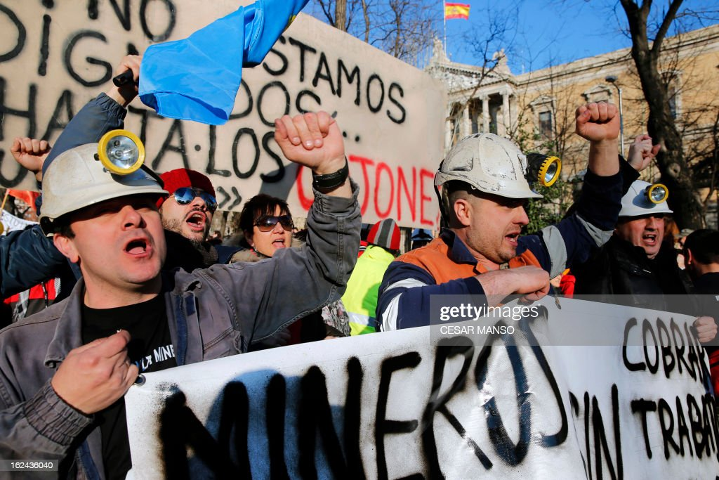 Miners take part in a protest against government austerity measures on February 23, 2013 in Madrid. Nurses, doctors, students, miners and members of Spain's 'indignant' movement against economic inequality join in the so-called 'citizens' tide' against the steep spending cuts and tax hikes imposed by Prime Minister Mariano Rajoy's conservative government to slash the public deficit. The day of protest coincides with the 31st anniversary of the failure of right-wing military coup that sought to crush Spain's young democracy and restore military rule.