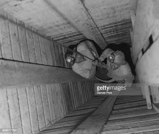Miners Tom McDonald top and Charles Bayrd descend the 75 ft shaft to the workings of Four Corners rich new mine near Morrison Credit Denver Post
