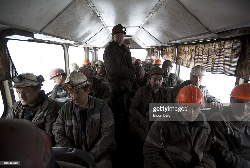 Miners wait to be transported off site by bus after finishing their shift at the Sibirginsky open pit coal mine, owned by OAO Mechel and operated by Southern Kuzbass Coal Co., near Myski, in Kemerovo region of Siberia, Russia, on Friday, Nov. 23, 2012. OAO Mechel is Russia's biggest maker of steelmaking coal. Photographer: Andrey Rudakov/Bloomberg via Getty Images