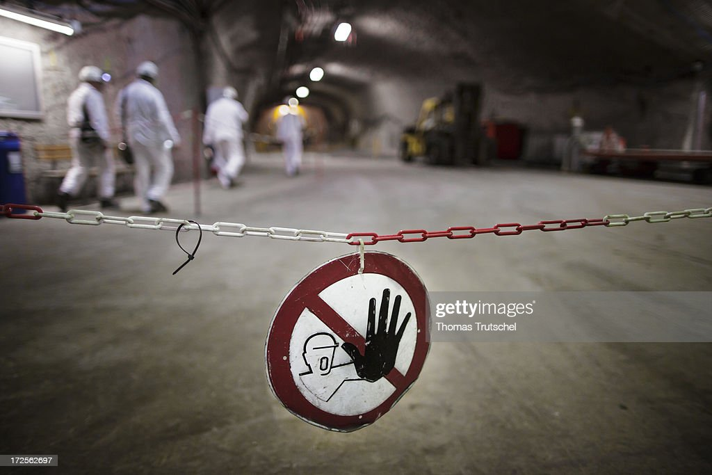 Miners walk behind a No Trespassing Sign in a tunnel in Gorleben Mine on July 3, 2013 in Gorleben, Germany. The German Bundestag agreed on June 28 to end radioactive transports to the Gorleben Mine while a commission of experts launches a search for a new nuclear waste disposal site.