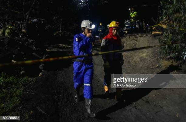 miners walk during search operations outside of 'La Guasca' mine in a rural area of Cucunuba Cundinamarca department on June 24 2017 An explosion at...