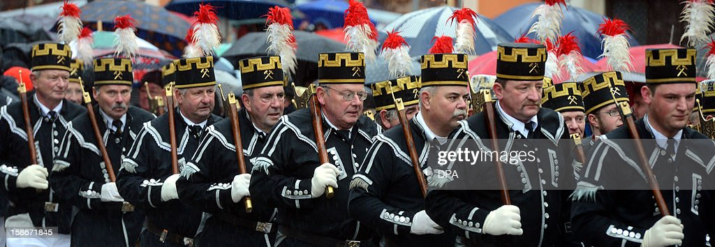 Miners wearing tradditional costumes take part in a christmas miners parade in Zwickau, eastern Germany, on December 23, 2012.The miners' parade is traditionally held in places in Germany where ore was smelted. OUT