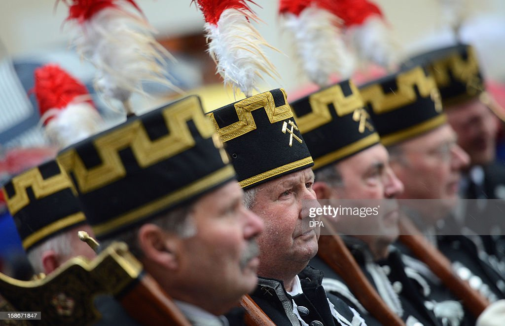Miners wearing tradditional costumes take part in a christmas miners parade in Annaberg-Buchholz, eastern Germany, on December 23, 2012.The miners' parade is traditionally held in places in Germany where ore was smelted. OUT