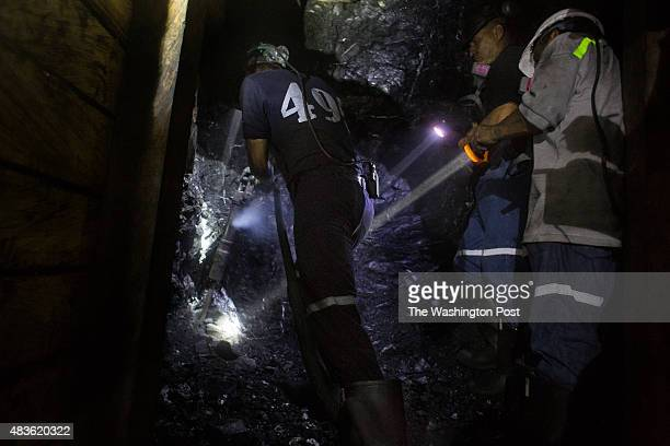Miners Wilmar Zapata Alexander Baena and Daniel Guerrero left to right dig through the Earth in the Puerto Arturo mine in the municipality of Muzo...