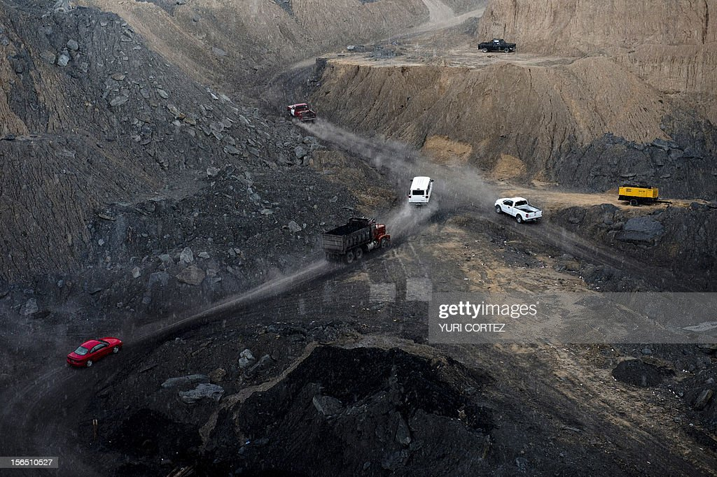 Miners with heavy machinery work in an opencast coal mine in Agujita, Coahuila State in Mexico on November 13, 2012. According to the Mining Chamber of Mexico, the country produces annually 15 million tons of coal, with an average annual production worth USD 3,800 million, representing 1.6% of the country's Gross Domestic Product (GDP) . The bulk of the coal is used for power generation and steel production. Recent press reports affirm that drugs cartel are involved in the coal-related activities.