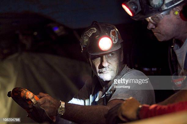 Miners work in Foresight Energy LLC's Pond Creek longwall coal mine in Johnson City Illinois US on Monday June 21 2010 In 2002 Foresight Energy owner...