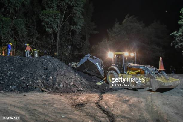 Miners works during search operations outside of 'La Guasca' mine in a rural area of Cucunuba Cundinamarca department Colombia on June 24 2017 An...
